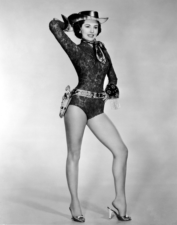 Cyd Charisse wearing a costume leotard with a cowgirl hat